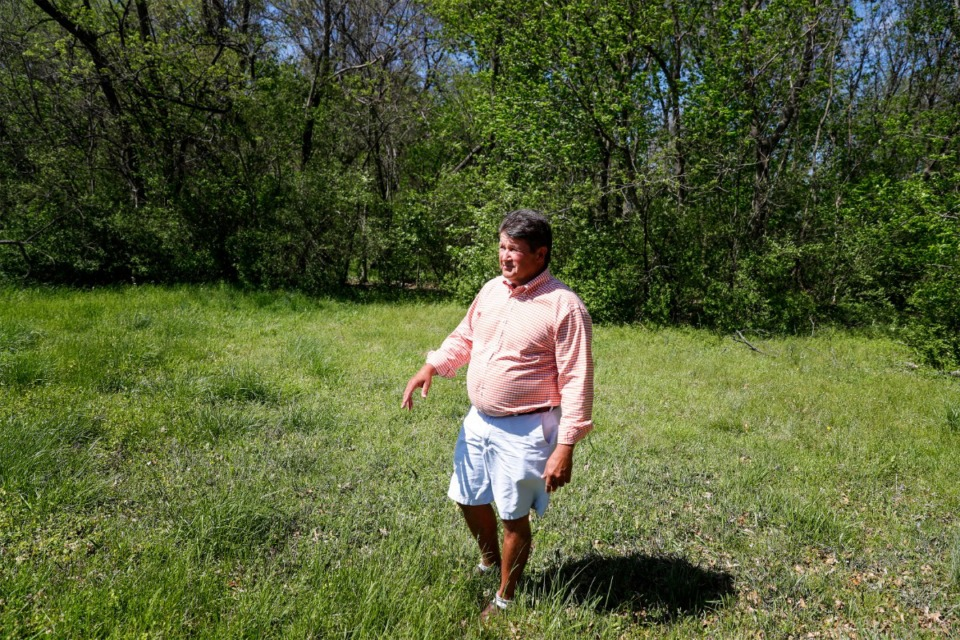 <strong>David Skinner walks his family&rsquo;s property near Poplar Avenue on April 8.&nbsp;Germantown aldermen voted unanimously Monday, April 12, to approve a zoning amendment for the property on the second of three readings.</strong> (Mark Weber/The Daily Memphian)