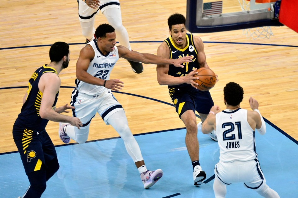 <strong>Indiana Pacers guard Malcolm Brogdon (7) drives against Grizzlies guard Desmond Bane (22) on April 11. It was another squeaker, one that the Grizz lost.</strong>&nbsp;(Brandon Dill/AP)