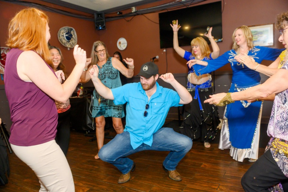 <strong>Trey Jewel couldn&rsquo;t resist dancing with the group of belly dancers during the audience participation in lessons by the Pyramid Dance Company at Ani Joe's Karaoke Kafe in Bartlett, Saturday, June 15, 2019.&nbsp;Health Directive No. 20 will have changes to dance rules for venues.</strong> (Greg Campbell/Special for The Daily Memphian file)