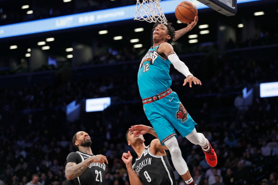<strong>In this March 4, 2020, file photo, Ja Airlines Flight 12 dunks as Brooklyn Nets forward Wilson Chandler (21) and guard Timothe Luwawu-Cabarrot (9) are caught flat-footed.</strong> (Kathy Willens/AP file)