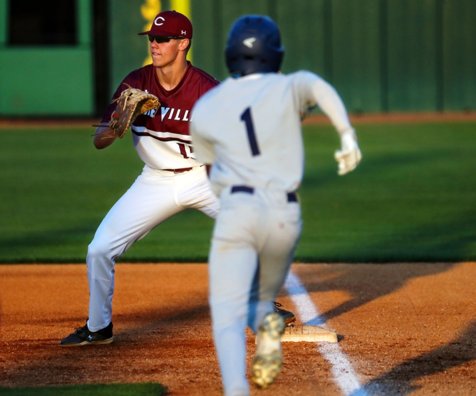 <strong>Collierville first baseman Grant Ross (15) receives the relay as Arlington centerfielder Josh Cooper (1) tries to beat the ball on April 13.</strong> (Patrick Lantrip/Daily Memphian)