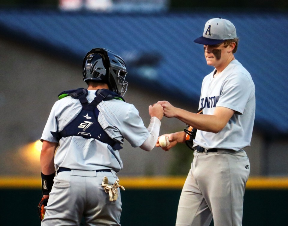 <strong>Arlington catcher Colbin Tyson fist-bumps pitcher Connor McCaslin after the former gave up a grand slam during the April 13 game against Collierville.</strong> (Patrick Lantrip/Daily Memphian)