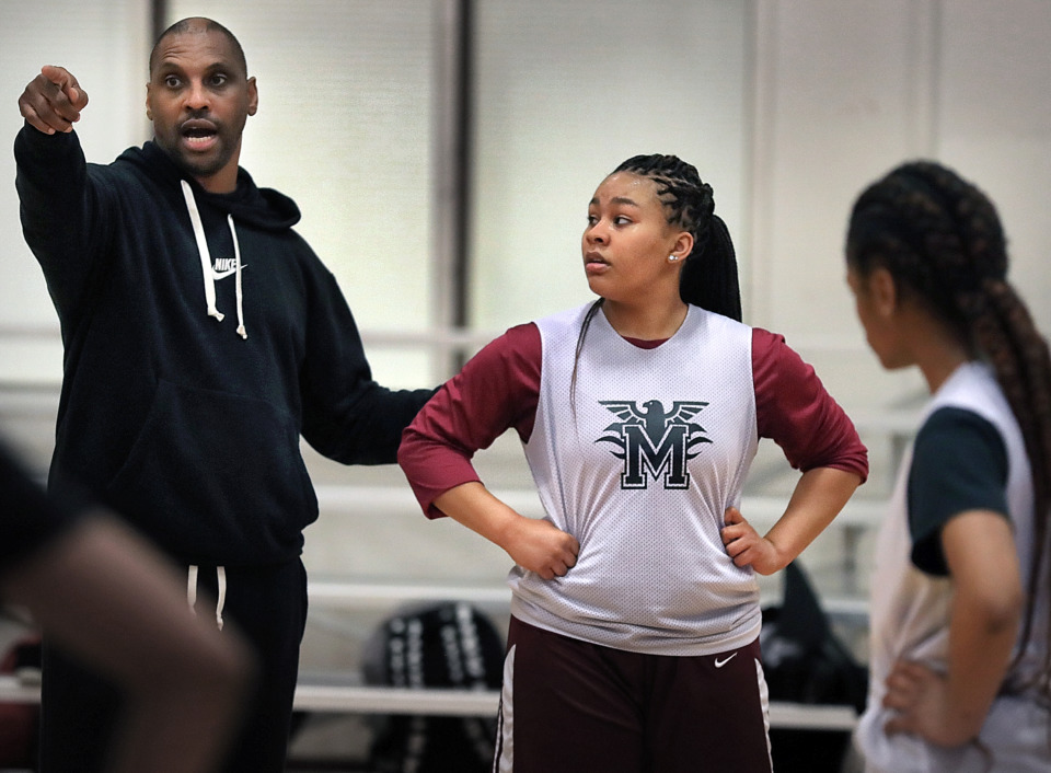 <strong>Coach Eric Daniels (left) works with Memphis Academy of Science and Engineering sophomore Ciara Taylor during practice with the girls' basketball team at the Mississippi Boulevard Christian Church gym on Jan. 16, 2019. &ldquo;She&rsquo;s mature beyond her years. She&rsquo;s just blessed with an ability to be mature for her age. She&rsquo;s a coach on the floor and a coach off the floor,&rdquo; said Daniels.</strong> (Jim Weber/Daily Memphian)