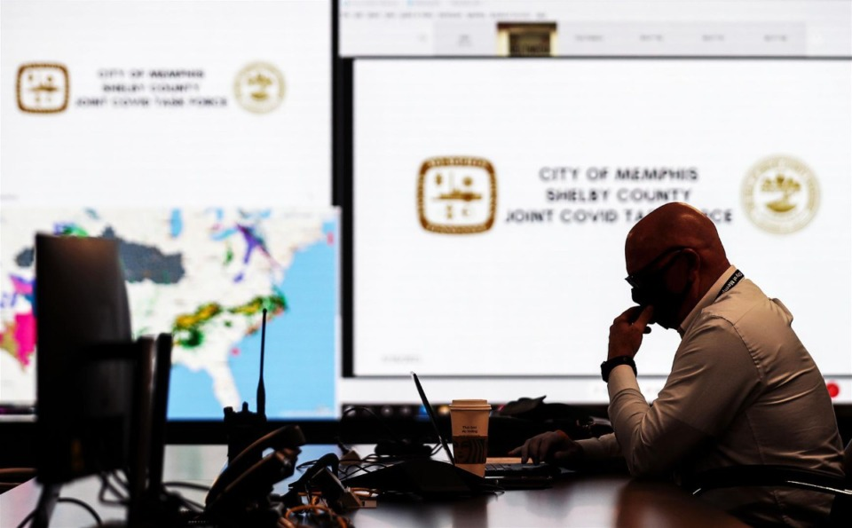 <strong>City of Memphis chief operating officer Doug McGowen looks over his notes shortly before a meeting of the COVID task force at the Office of Emergency Management March 16, 2021.</strong> (Patrick Lantrip/Daily Memphian)