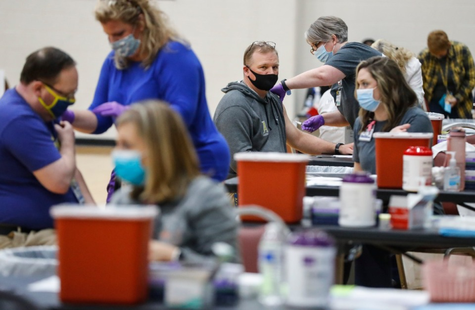 <strong>Volunteers administer COVID vaccine shots to municipal and school employees from Arlington, Millington and Lakeland during Arlington High School&rsquo;s vaccination event on Friday, March 26, 2021.</strong> (Mark Weber/The Daily Memphian)