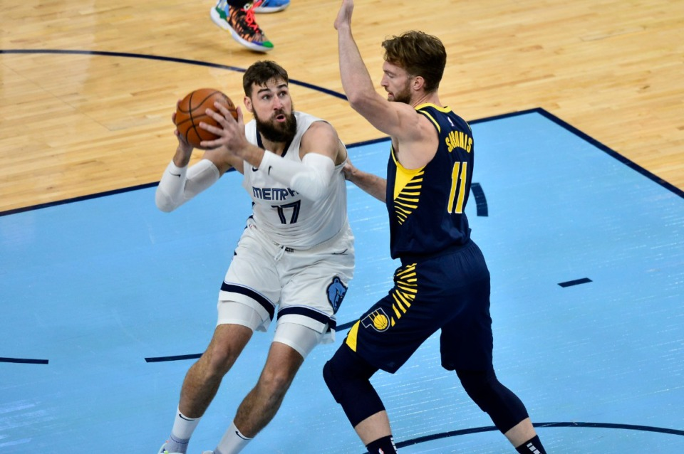 <strong>Memphis Grizzlies center Jonas Valanciunas (17) handles the ball against Indiana Pacers forward Domantas Sabonis (11) in the first half of an NBA basketball game Sunday, April 11, 2021, in Memphis</strong>. (AP Photo/Brandon Dill)