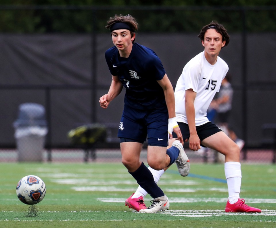 <strong>Lausanne's Max Gilbert (7) brings the ball up the pitch during the game against Houston on April 15.</strong> (Patrick Lantrip/Daily Memphian)