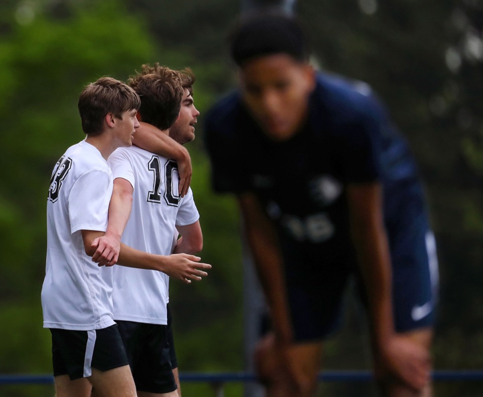 <strong>Houston players celebrate a goal as a Lausanne player stares in disbelief on April 15.</strong> (Patrick Lantrip/Daily Memphian)