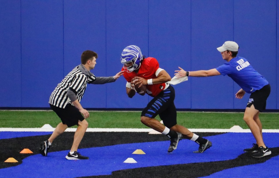 <strong>Tigers quarterback Keilon Brown (middle) runs through drills during practice on March 23. Brown is one of four QBs battling for the starting spot for U of M.</strong> (Mark Weber/The Daily Memphian)
