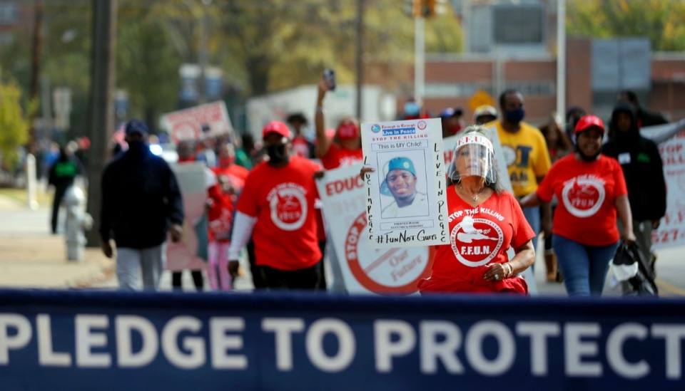 <strong>Rosiland Moore (in a Nov. 14, 2020 Unity Walk to end gun violence) held a sign remembering her son, Prentice, who was killed in 2003.</strong> (Patrick Lantrip/Daily Memphian file)