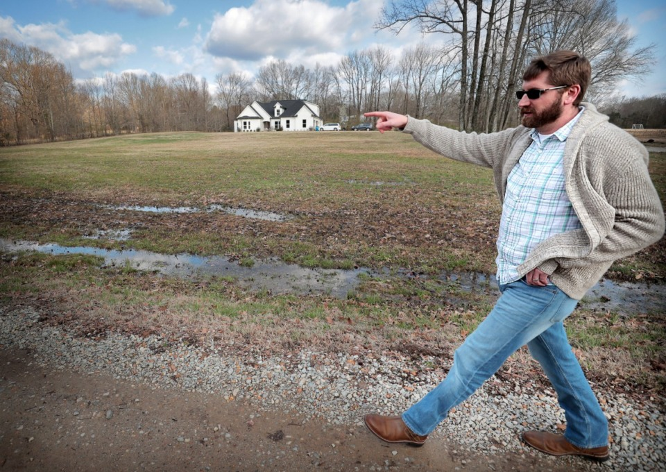 <strong>Chris Pilcher (in a Feb. 20, 2020 file photo) points out where the proposed route of the Byhalia Connection pipeline will run near his rural DeSoto County home.</strong> (Jim Weber/Daily Memphian file)