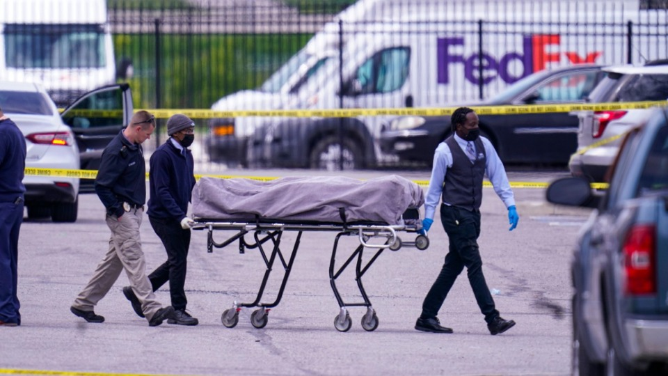 <strong>A body is taken from the scene where multiple people were shot at a FedEx Ground facility in Indianapolis, Friday, April 16, 2021. A gunman killed eight people and wounded several others before apparently taking his own life in a late-night attack at a FedEx facility near the Indianapolis airport, police said.</strong> (Michael Conroy/AP)