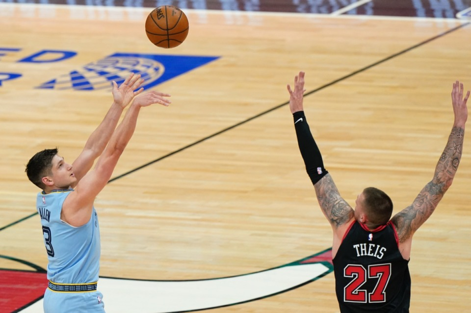 <strong>Grizzlies guard Grayson Allen, left, shoots over Chicago Bulls center Daniel Theis on April 16 in Chicago.</strong> (Nam Y. Huh/AP)