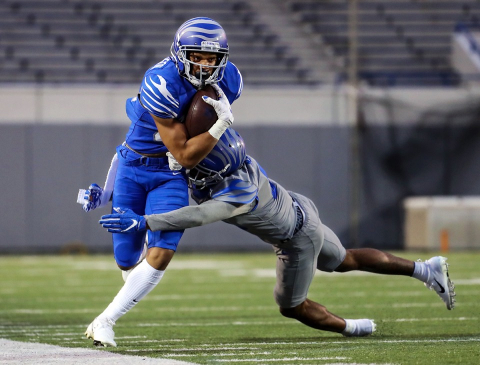 <strong>University of Memphis wide receiver Ka'Dedrick Richardson (32) fights for extra yardage during the Tigers&rsquo; spring game at the Liberty Bowl April 16, 2021.</strong> (Patrick Lantrip/Daily Memphian)