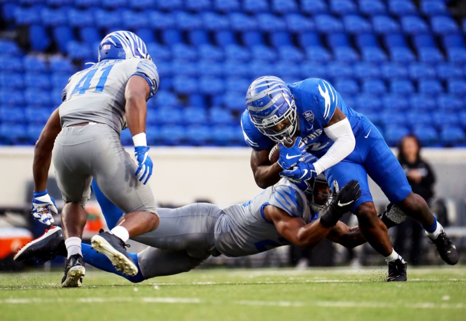 <strong>University of Memphis running back Rodrigues Clark (2) is brought down after a run during the Tigers&rsquo; spring game at the Liberty Bowl April 16.</strong> (Patrick Lantrip/Daily Memphian)