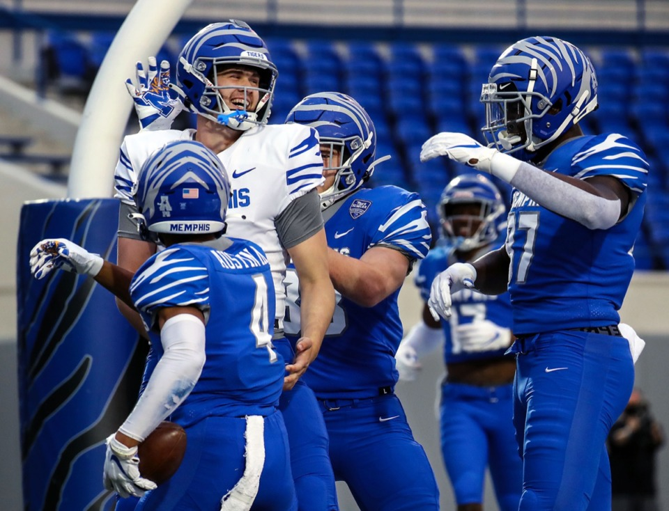 <strong>University of Memphis quarterback Grant Gunnell (7) celebrates with teammates after throwing a touchdown during the Tigers&rdquo; spring game at the Liberty Bowl on April 16, 2021.</strong> (Patrick Lantrip/Daily Memphian)