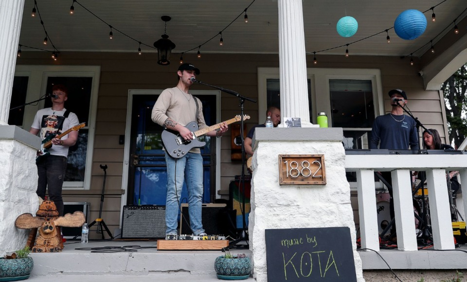 <strong>Indie rock group Music by KOTA performs on a Felix Avenue porch during Cooper-Young Porchfest 2021 April 17, 2021.</strong> (Patrick Lantrip/Daily Memphian)