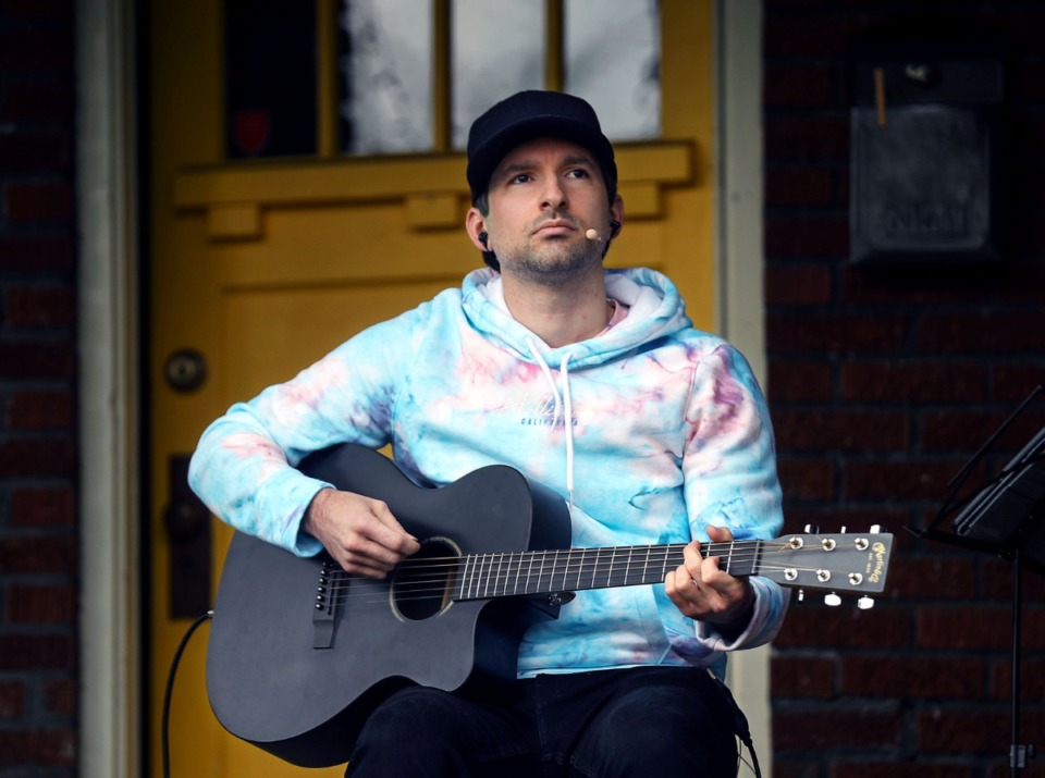 <strong>Singer/songwriter Kris Acklen performs on a porch on Evelyn Avenue during Cooper-Young Porchfest 2021 April 17, 2021.</strong> (Patrick Lantrip/Daily Memphian)
