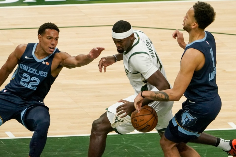 <strong>Milwaukee Bucks' Bobby Portis battles for the ball with Memphis Grizzlies' Desmond Bane and Kyle Anderson during the first half of an NBA basketball game Saturday, April 17, 2021, in Milwaukee.</strong> (Morry Gash/AP)