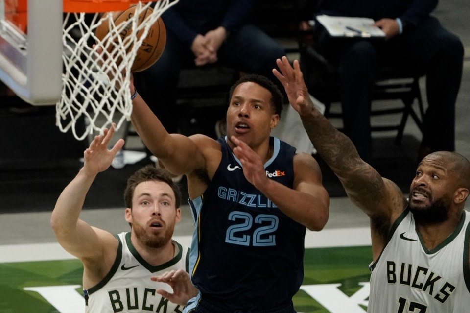 <strong>Memphis Grizzlies' Desmond Bane shoots past Milwaukee Bucks' P.J. Tucker and Pat Connaughton during the second half of an NBA basketball game Saturday, April 17, 2021, in Milwaukee.</strong> (Morry Gash/AP)