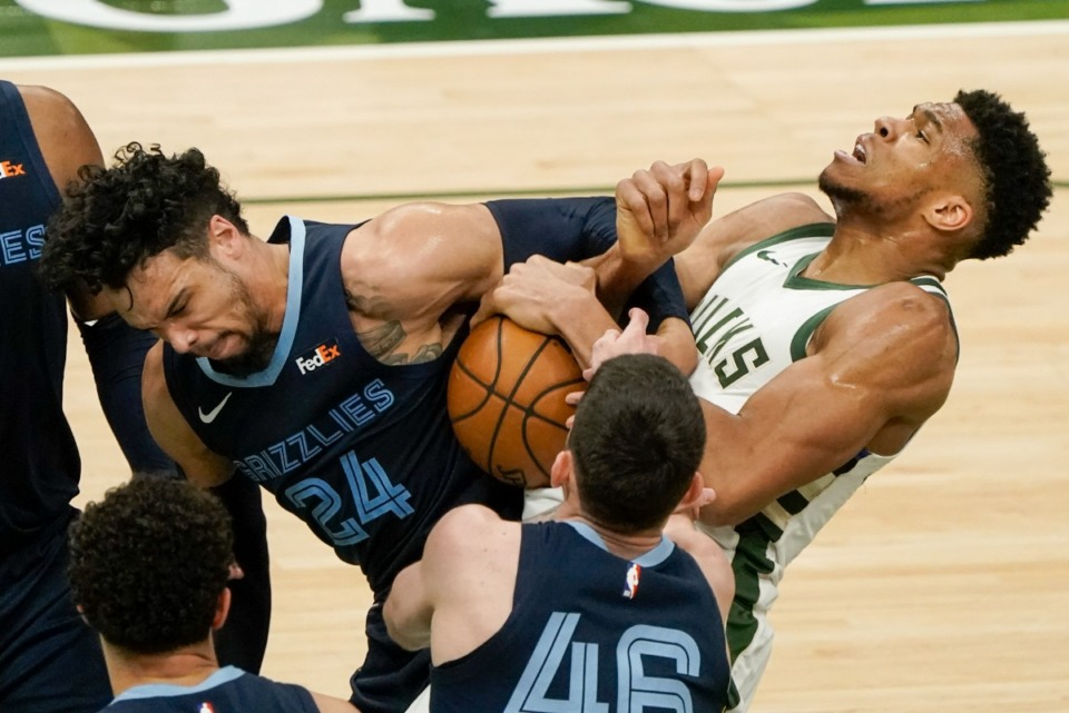 <strong>Milwaukee Bucks' Giannis Antetokounmpo and Memphis Grizzlies' Dillon Brooks battle for a loose ball during&nbsp;an NBA basketball game Saturday, April 17, 2021, in Milwaukee.</strong> (Morry Gash/AP)
