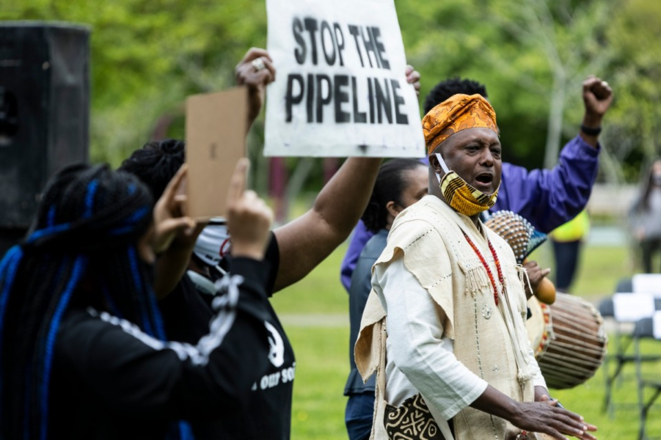 <strong>Ekpe Abioto plays the djembe during a rally supporting the Memphis Community Against the Pipeline at Alonzo Weaver Park.</strong> (Brad Vest/Special to The Daily Memphian)