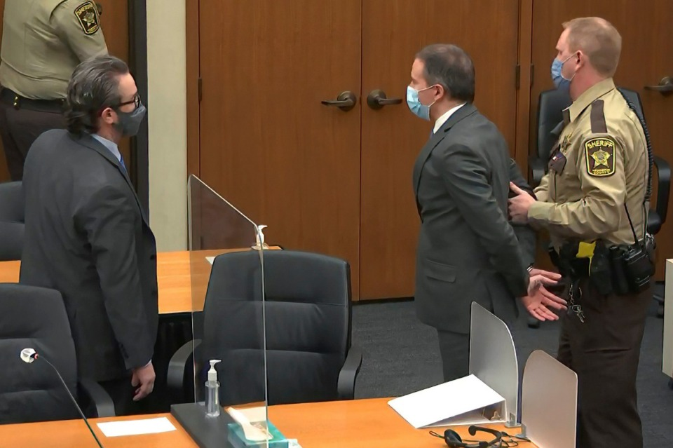 <strong>In this image from video, former Minneapolis police officer Derek Chauvin is taken into custody as his attorney Eric Nelson, left, watches, after he was found guilty on all three counts in his trial for the 2020 death of George Floyd, Tuesday, April 20, 2021, at the Hennepin County Courthouse in Minneapolis.</strong> (Court TV via AP, Pool)