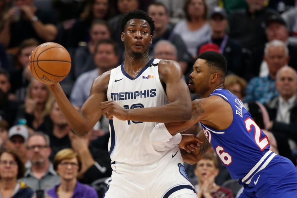 <strong>Grizzlies forward Jaren Jackson Jr. (with ball), seen here in 2020, has been upgraded to questionable.</strong> (Rich Pedroncelli/AP)