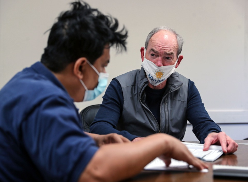 <strong>ESL volunteer Davis Woods works with Hung Nguyen, who immigrated from Vietnam five years ago at the Collierville Literacy Council April 21, 2021.</strong> (Patrick Lantrip/Daily Memphian)