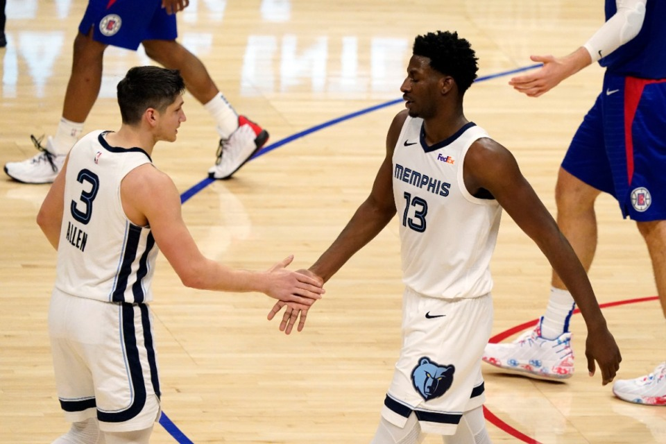 <strong>Grizzlies forward Jaren Jackson Jr. (13) shakes hands with guard Grayson Allen (3) on April 21 in the game against the Clippers in Los Angeles.</strong> (AP Photo/Marcio Jose Sanchez)