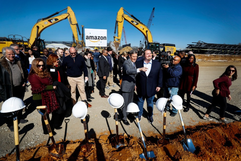 <strong>Tennessee Gov. Bill Lee (middle left) and Amazon Director of Regional Operations Rob Packett (middle right) attended a press conference announcing a new Amazon fulfillment center Monday, Jan. 27, 2020 in Raleigh-Frayser.</strong> (Mark Weber/Daily Memphian file)