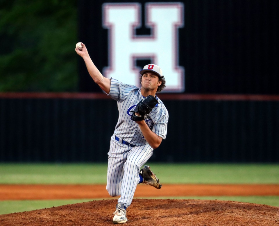 <strong>MUS pitcher Nash Stewart (12) throws to the plate during the April 22 game against Houston.</strong> (Patrick Lantrip/Daily Memphian)