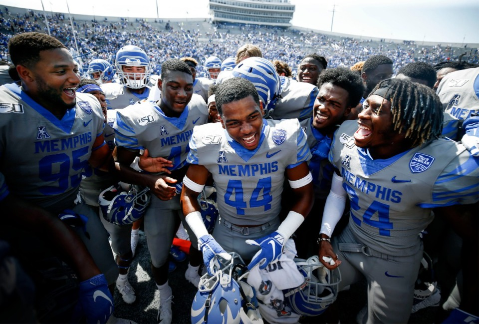 <strong>Memphis defensive back Kendell Johnson (middle) and his teammates celebrate a 15-10 victory over Ole Miss at Liberty Bowl Memorial Stadium on Aug. 31, 2019.</strong> (Mark Weber/Daily Memphian file)