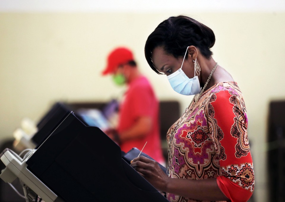 <strong>A voter lodges her choices at the Arlington United Methodist Church on Aug. 6, 2020. A dispute over a new voting machines is ongoing.</strong> (Patrick Lantrip/Daily Memphian file)