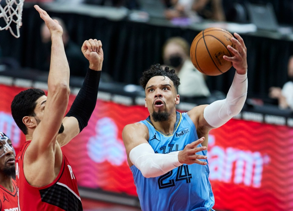 <strong>Grizzlies forward Dillon Brooks, right, shoots over Portland Trail Blazers center Enes Kanter on April 23, 2021.</strong> (Craig Mitchelldyer/AP)