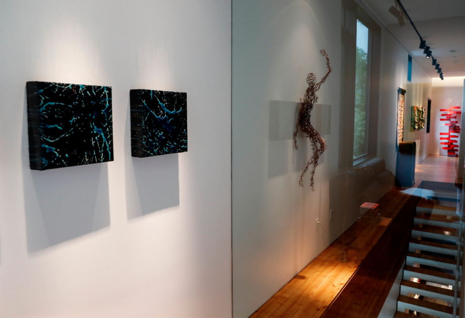 <strong>A gallery wall runs the length of the second floor inside the home.</strong> (Mark Weber/The Daily Memphian)
