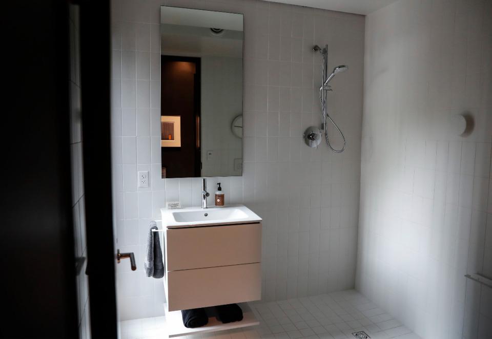<strong>A bathroom in the home features an open concept design.</strong> (Mark Weber/The Daily Memphian)