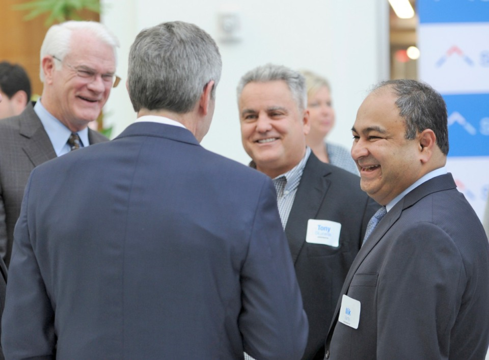 <strong>Tony DiLucente (center) and former ServiceMaster CEO Nik Varty (right) greeted visitors including former Shelby County Mayor Mark Luttrell (left), during the opening of One ServiceMaster Center.</strong> (Greg Campbell/Special to Daily Memphian)