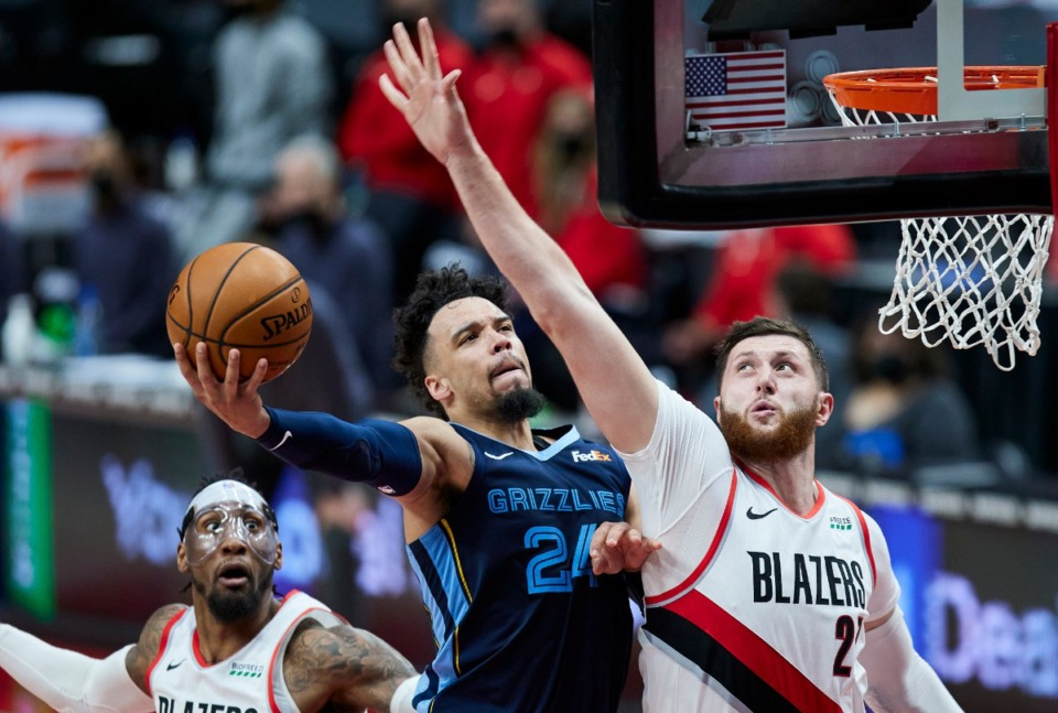 <strong>Memphis Grizzlies forward Dillon Brooks, left, shoots over Portland Trail Blazers center Jusuf Nurkic during the second half of an NBA basketball game in Portland, Ore., Sunday, April 25, 2021.</strong> (Craig Mitchelldyer/AP)