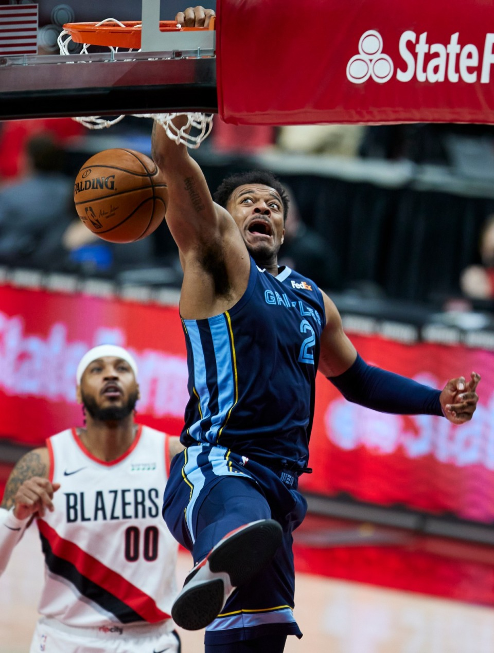 <strong>Memphis Grizzlies center Xavier Tillman dunks in front of Portland Trail Blazers forward Carmelo Anthony during the second half of an NBA basketball game in Portland, Ore., Sunday, April 25, 2021.</strong> (Craig Mitchelldyer/AP)