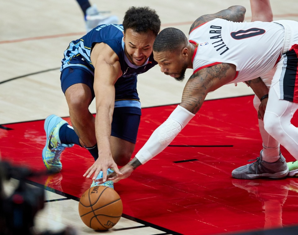 <strong>Memphis Grizzlies forward Kyle Anderson, left, and Portland Trail Blazers guard Damian Lillard reach for a loose ball during the second half of an NBA basketball game in Portland, Ore., Sunday, April 25, 2021.</strong> (Craig Mitchelldyer/AP)