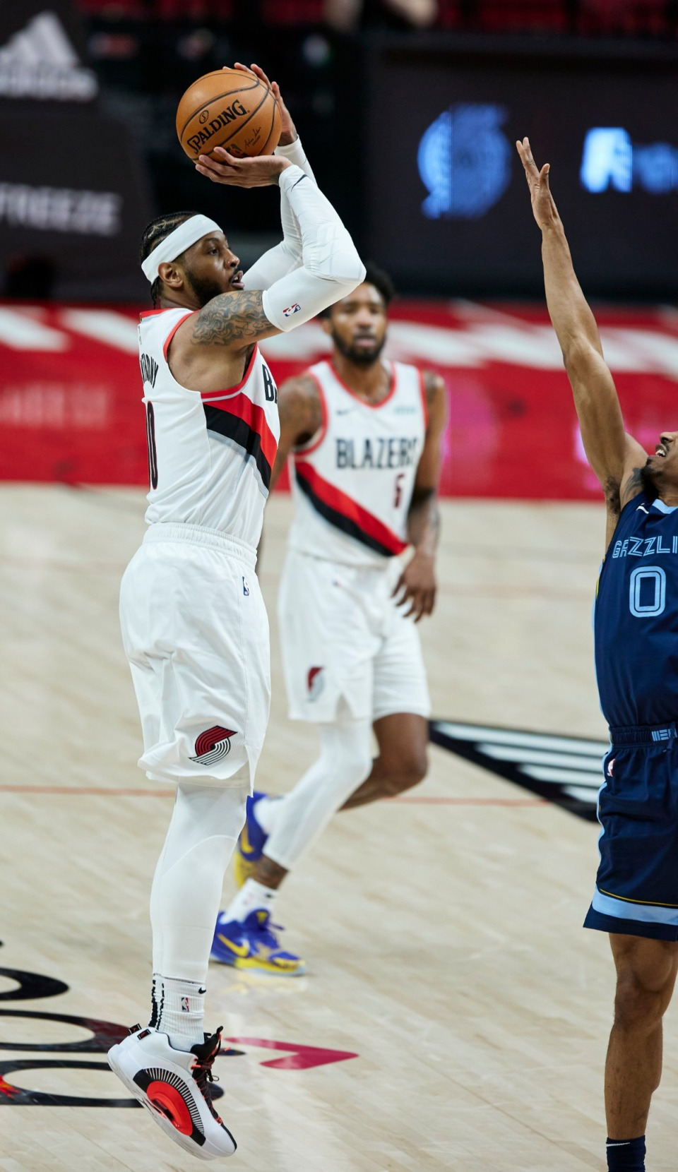 <strong>Portland Trail Blazers forward Carmelo Anthony, left, shoots a three-point basket over Memphis Grizzlies guard De'Anthony Melton during the first half of an NBA basketball game in Portland, Ore., Sunday, April 25, 2021.</strong> (Craig Mitchelldyer/AP)