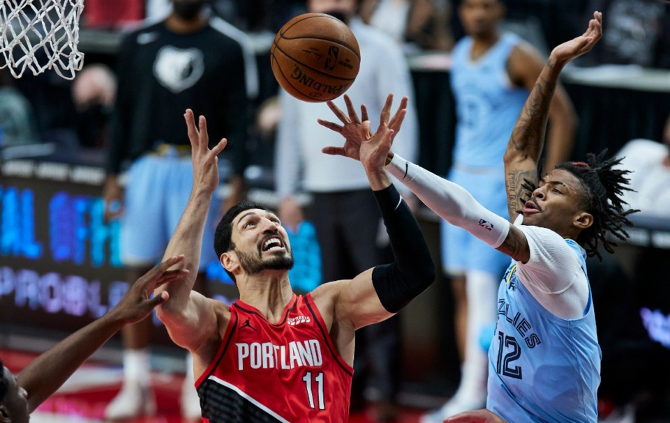 <strong>Portland Trail Blazers center Enes Kanter, left, and Memphis Grizzlies guard Ja Morant reach for a rebound during an NBA basketball game in Portland, Ore., Friday, April 23, 2021.</strong> (Craig Mitchelldyer/AP)