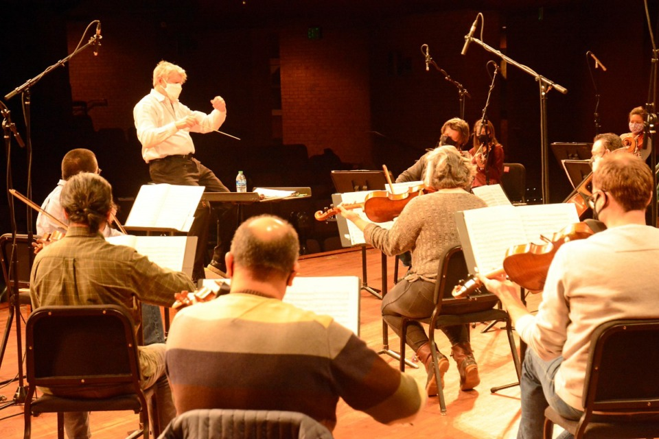 <strong>Michael Stern conducts Iris Orchestra during a rehearsal. The group will hold its first live performance before an audience in over a year Saturday, May 1 at The Grove at GPAC.</strong> (Courtesy GPAC)