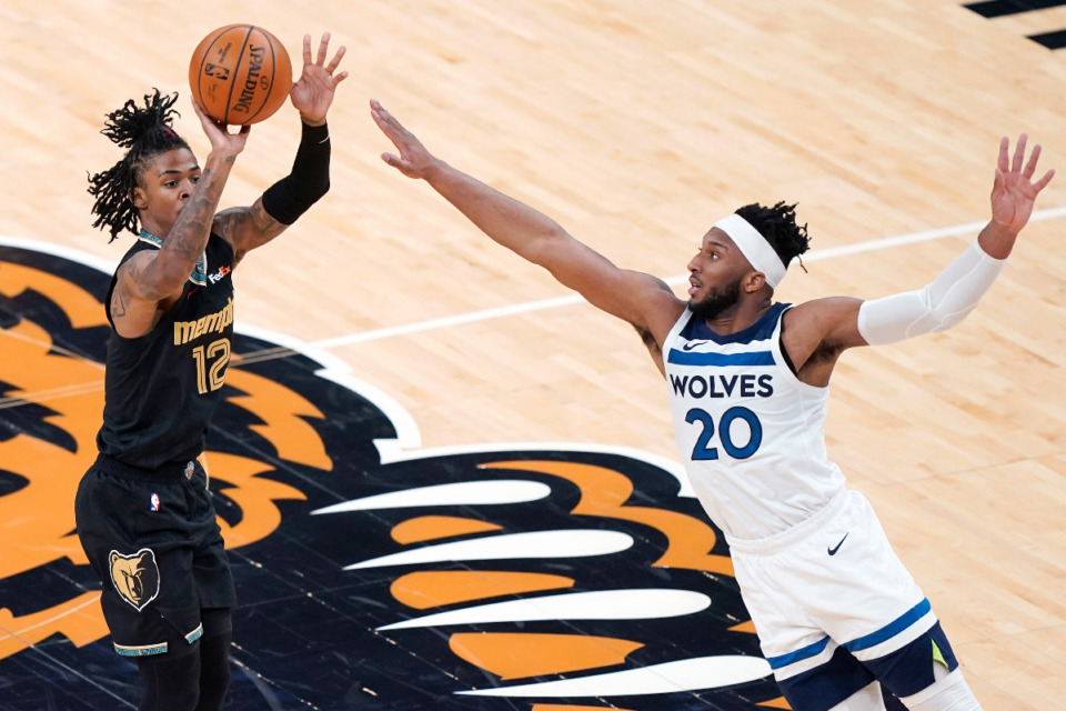 <strong>Memphis Grizzlies' Ja Morant (12) shoots over the reach of Minnesota Timberwolves' Josh Okogie (20) in the first half of an NBA basketball game Friday, April 2, 2021, in Memphis, Tenn.</strong> (AP Photo/Mark Humphrey file)