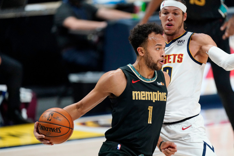 <strong>Memphis Grizzlies forward Kyle Anderson, front, drives around Denver Nuggets forward Aaron Gordon in the first half of an NBA basketball game Monday, April 26, 2021, in Denver.</strong> (AP Photo/David Zalubowski)