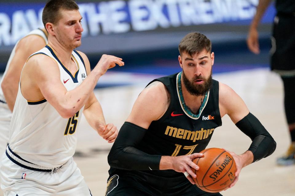 <strong>Memphis Grizzlies center Jonas Valanciunas, right, moves to the rim as Denver Nuggets center Nikola Jokic defends in the first half of an NBA basketball game Monday, April 26, 2021, in Denver.</strong> (AP Photo/David Zalubowski)