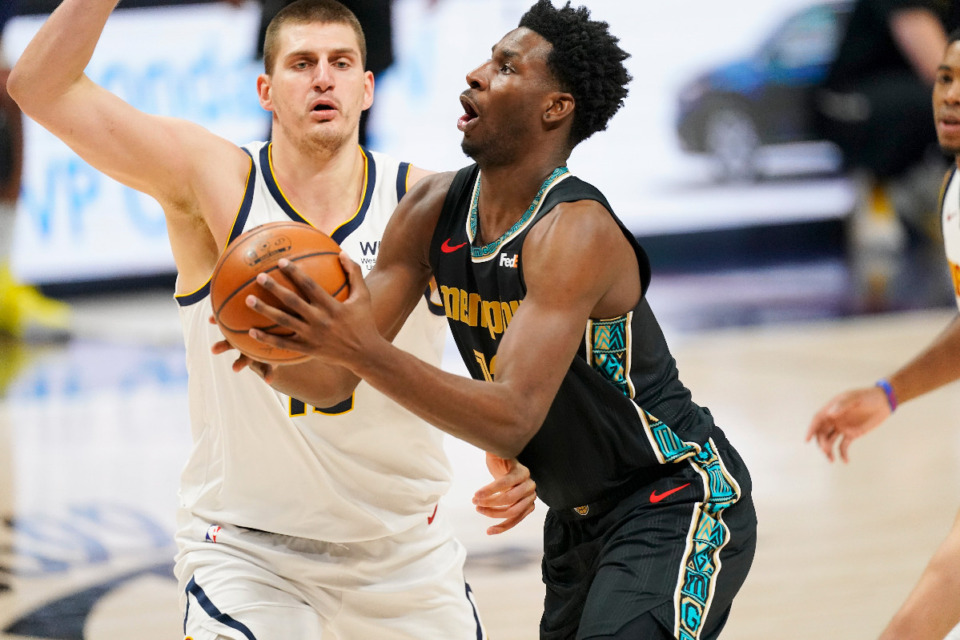 <strong>Memphis Grizzlies forward Jaren Jackson Jr., drives to the rim past Denver Nuggets center Nikola Jokic, April 26, 2021, in Denver. Jackson will look to play in his fourth game of the season Wednesday at home against Portland. </strong>(AP Photo/David Zalubowski file)