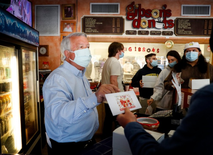 Gibson's Donuts owner Don DeWeese hands out letters on Wednesday, April 21, letting customers know their donuts are being paid for by The Kindness Revolution. In return, the organization asked customers to perform an act of kindness for someone that same day. (Mark Weber/Daily Memphian)