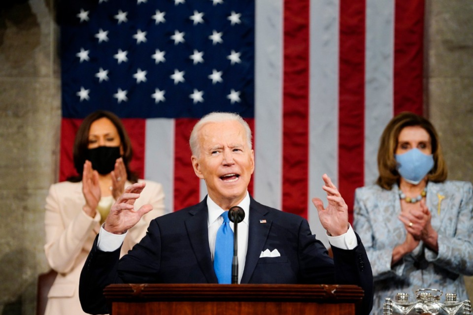 <strong>Vice President Kamala Harris, and House Speaker Nancy Pelosi of Calif., stand and applaud as President Joe Biden addresses a joint session of Congress on April 28, 2021, in the House Chamber at the U.S. Capitol in Washington.</strong> (Melina Mara/The Washington Post via AP, Pool)